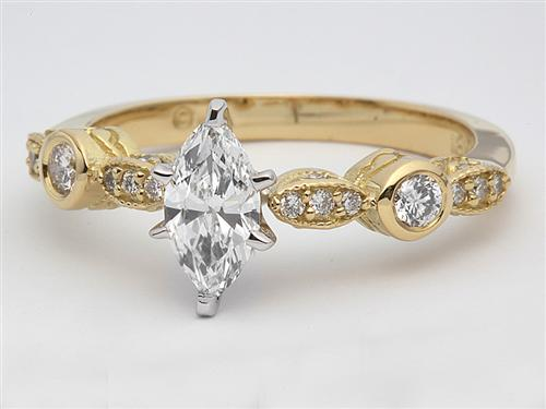 Gold 0.45 Marquise cut Diamond Ring With Sidestones