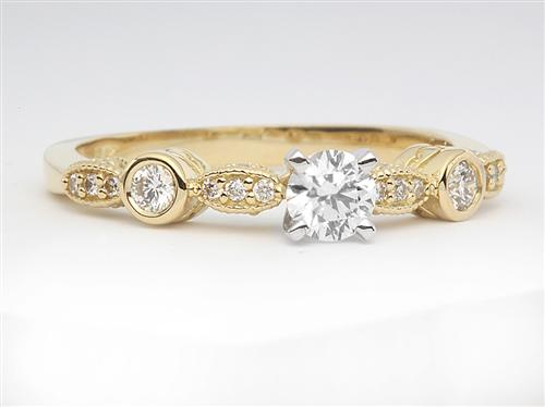 Gold 0.30 Round cut Sidestone Engagement Ring