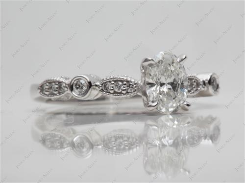 White Gold 0.61 Oval cut Side Stone Engagement Ring
