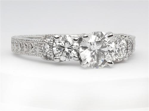 Platinum 0.72 Round cut Engagement Rings With Side Stones