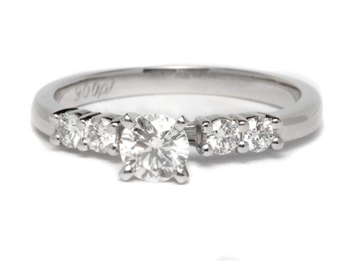 Platinum 0.32 Round cut Engagement Rings With Sidestones