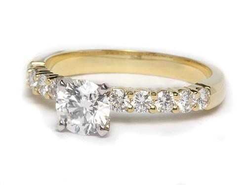Gold 0.77 Round cut Side Stone Engagement Ring