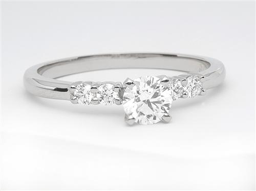 Platinum 0.51 Round cut Sidestone Engagement Ring