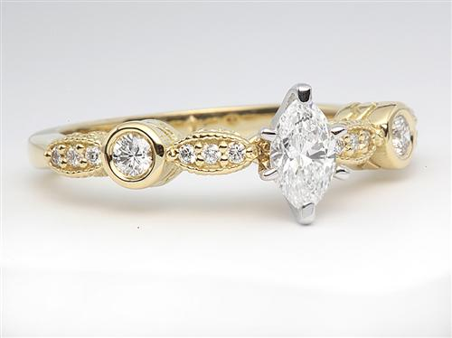 Gold 0.32 Marquise cut Engagement Ring With Sidestones