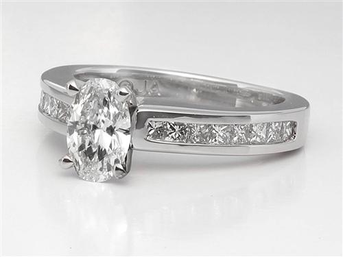 Platinum 0.74 Oval cut Side Stone Engagement Ring