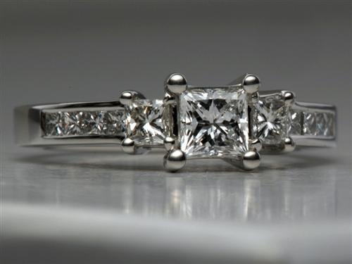 Platinum 0.54 Princess cut Sidestone Engagement Ring