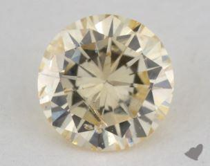 round0.32 Carat fancy light orangy yellowI1