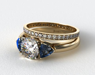 18k Yellow Gold Three Stone Trillion Shaped Blue Sapphire Engagement Ring & 0.26ct Pave Eternity Band