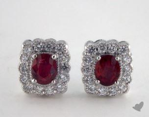 18K White Gold Diamond Framed 0.80tcw Oval Ruby Earrings.